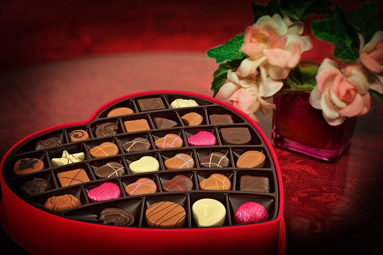 Heart-shaped box of chocolates and flowers